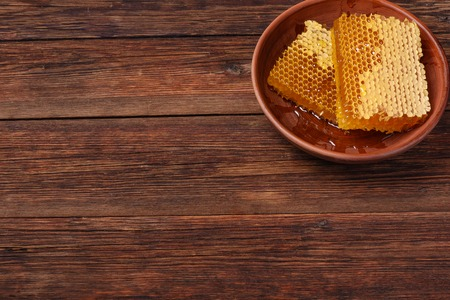 table top: honeycomb on a wooden table top view Stock Photo