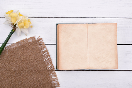Blank notebook with flower on old vintage wooden table background top view Reklamní fotografie
