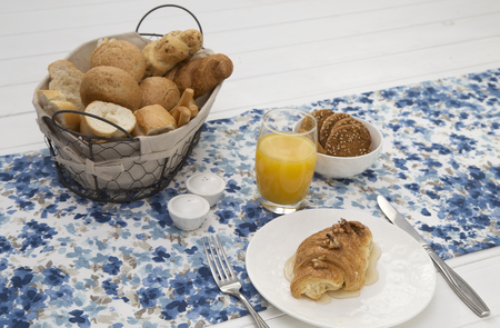 Continental breakfast with fresh croissants, biscuits, bread, jam and orange juice on table Stok Fotoğraf