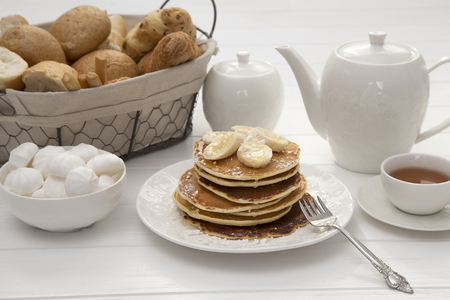 Breakfast with pancakes and tea