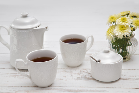 teatime cups of tea on wooden white table