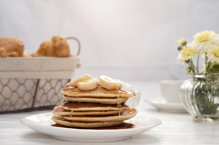 pancakes on wooden table, closeup