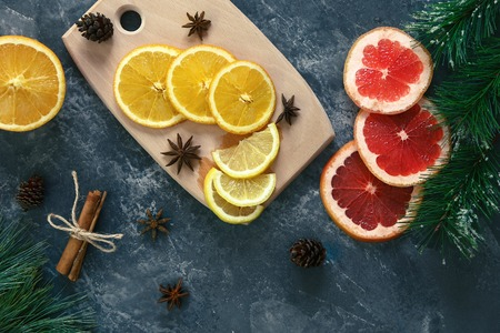 Citrus fruits on a wooden board on a dark background Stok Fotoğraf