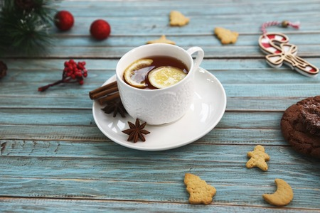 Cup of tea and cookies on wooden table. Christmas, winter xmas concept. Flat lay top view. Stok Fotoğraf