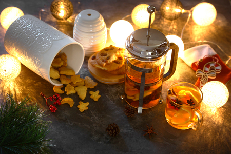 Gingerbread cookies and tea with christmas light background Stok Fotoğraf