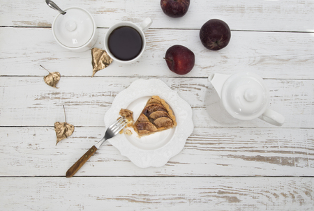 Homemade apple pie with cinnamon and cup of tea on white wooden table. Top view. Stok Fotoğraf