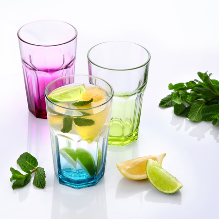 Classic lemonade with mint and lemon slices on light background, copy space