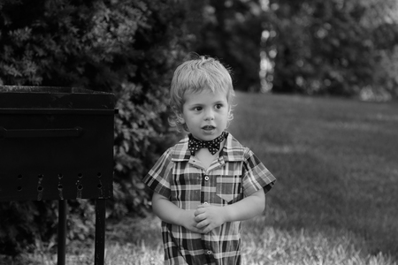 Little boy in shirt and bow tie in the park Black & White