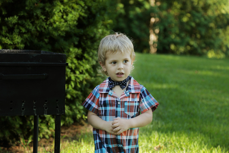 Little boy in shirt and bow tie in the park