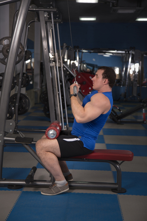 wristbands: beautiful, powerful, strong man posing at the gym