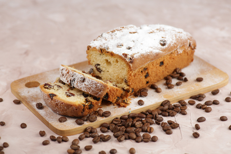 Delicious homemade cake with raisins on a light wooden background. close-up. rustic. copy space. Reklamní fotografie