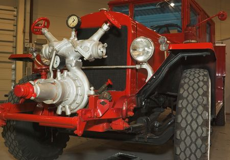 antique fire truck: red antique restored firefighters truck  Stock Photo