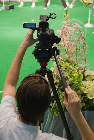reportage: News maker on reportage recording with camcoder