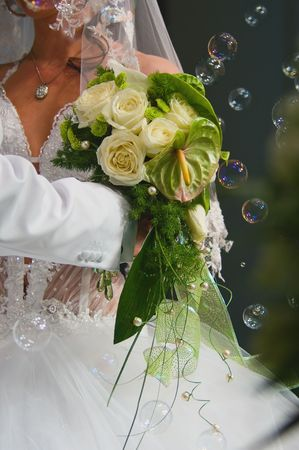 Bride with bouquet and grasses Standard-Bild