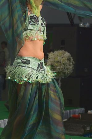 Belly Dancer with coin decorated costume and jewelery