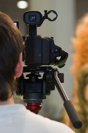 News maker on reportage recording with camcoder