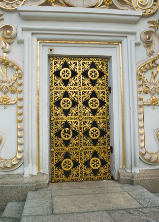 An ancient wooden door with wrought iron ornaments photo