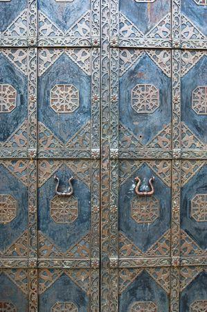 Black iron doors in old building in Kiev photo