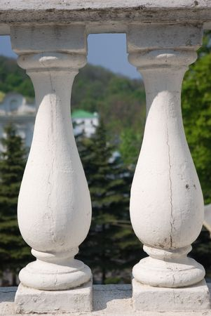 Closeup of stone balustrade in white photo