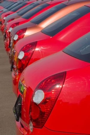 A row of new cars parked at a car dealer shop Reklamní fotografie