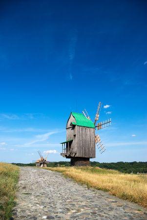 ethnographic: Old wooden windmills at Pirogovo ethnographic museum, near Kyiv, Ukraine Stock Photo