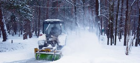 Tractor cleaning snow in winter Park