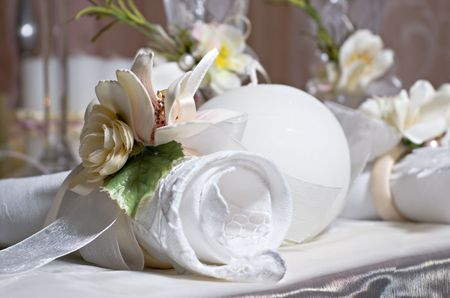 Twisted napkin decorated with flowers lies on the holiday table photo