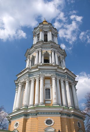 The tall belfry of Kiev pechersk Lavra, Ukraine with gold dome and cross photo