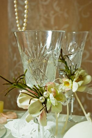 Wedding glasses decorated with bouquets of flowers photo