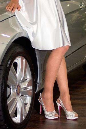 girl with beautiful legs near a car photo