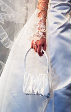 young bride with a small white bag photo