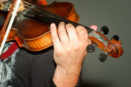 Musician playing violin isolated on gray photo