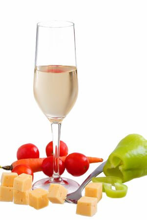 Glass of white wine with various types of cheese and garnishes on a white background photo