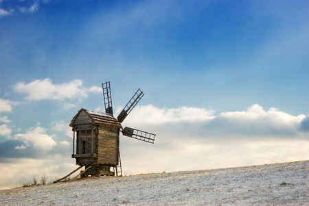 Old wooden windmills at Pirogovo ethnographic museum, near Kiev, Ukraine  photo