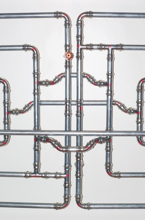 interlacing water-pipes on the wall in the bathroom