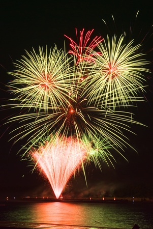 Many golden fireworks bursts at fireworks festival. Stock Photo - 11439234