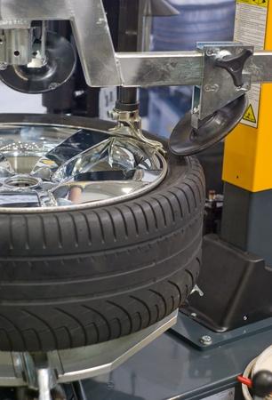 tire repair shop: wheel repair in auto service station Editorial