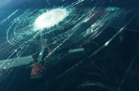 broken car: the broken windshield in car accident  Stock Photo