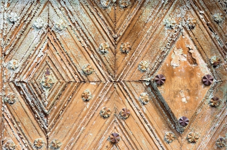 oxidized: Close up of fragment of old wooden door with oxidized forged steel knockers and nails  rivets   Fine texture of antique wood   Stock Photo