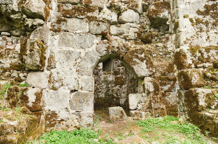Fragment of the old fortress wall with the entrance to the tower