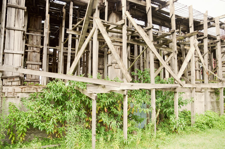 structural engineers: huge wood scaffold closeup on an old building exterior Editorial