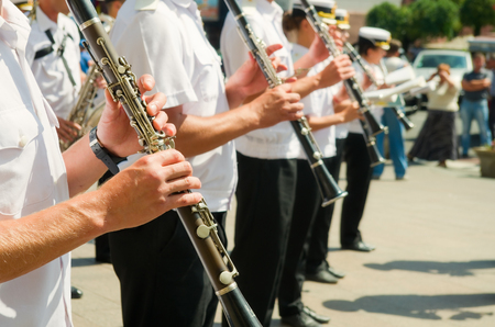 Musicians of military band playing on a street