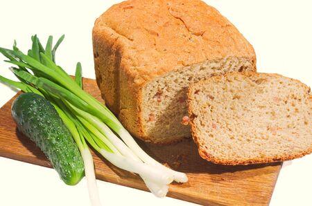 Freshly baked bread and vegetables on a white background Standard-Bild