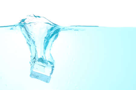 Throw ice into the water making a clear blue splash water wave, isolated on a white background. with copy space