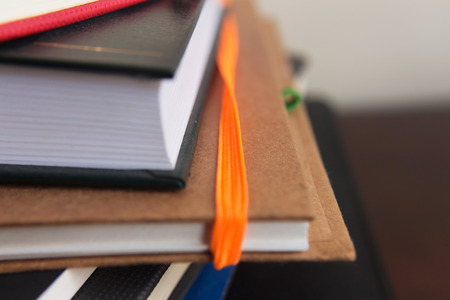 Close up capture of notebooks with different colors