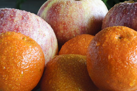 Compostion close up of fresh mandarins and apples