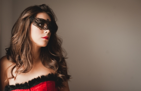 Young and sexy girl with masquerade photo