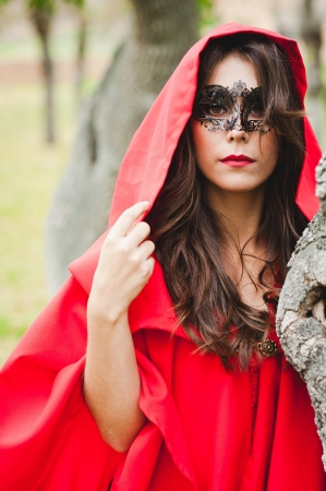 Portrait of a masked Red Riding Hood Stock Photo - 16640795