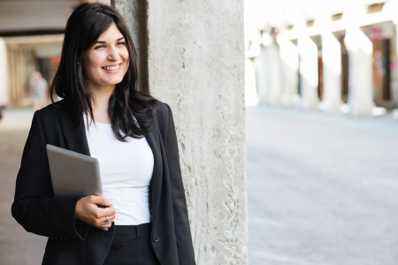 entrepeneur: Young entrepeneur holding a tablet and smiling Stock Photo