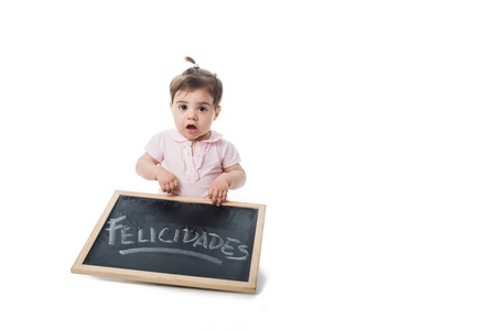 handwrite: Surprised baby with a chalkboard with felicidades handwrite